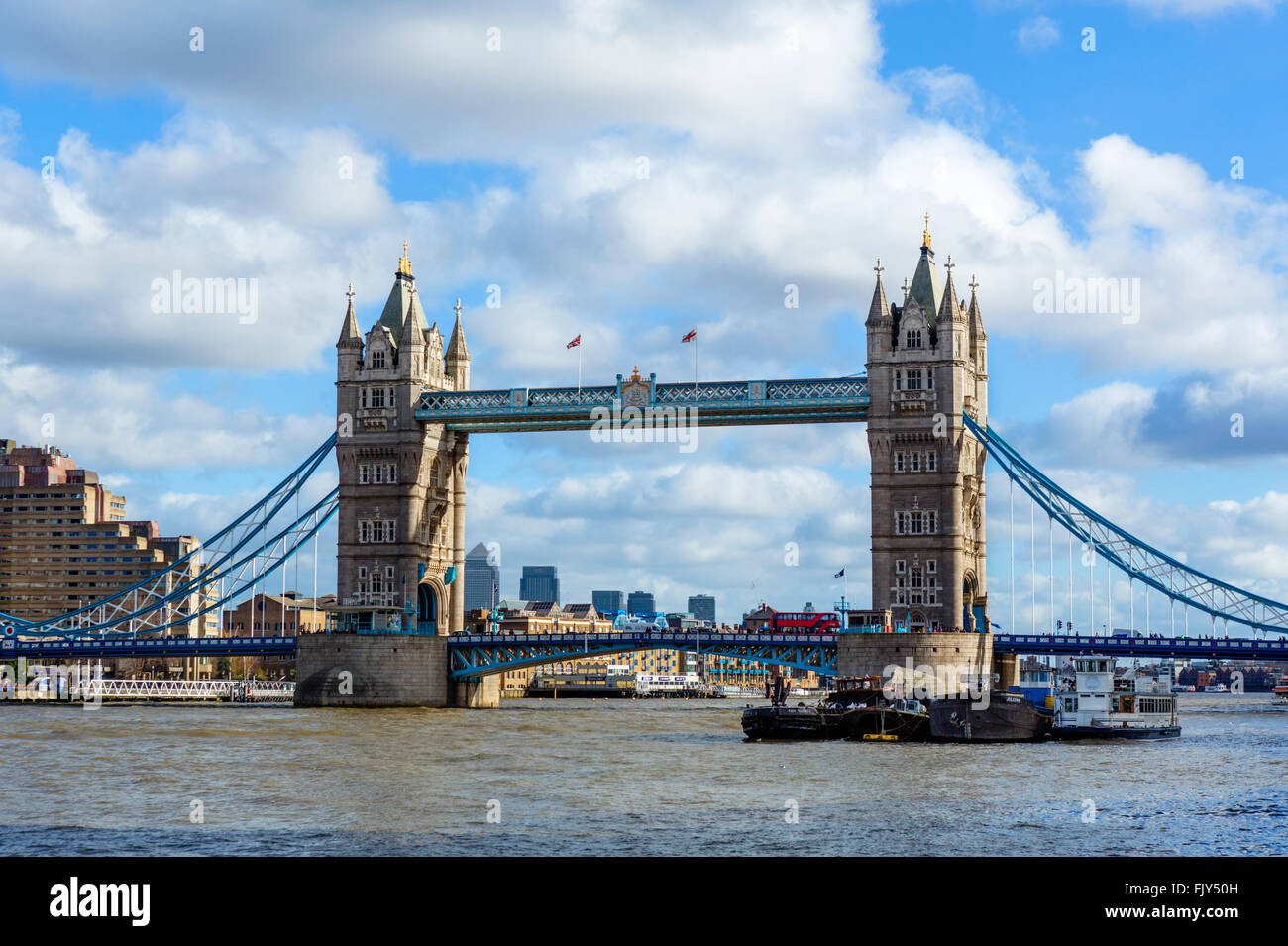 Tower Bridge from the South Bank with the skyscrapers of Canary Wharf in the distance, London, England, UK - Stock Image