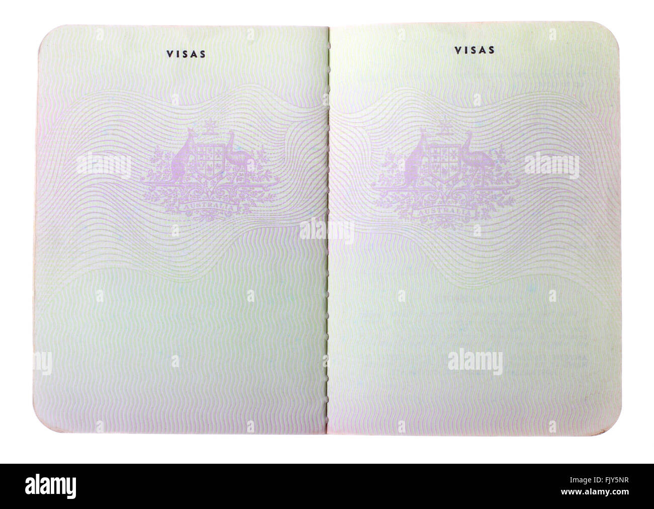 Blank old Australian passport pages isolated on white background. - Stock Image