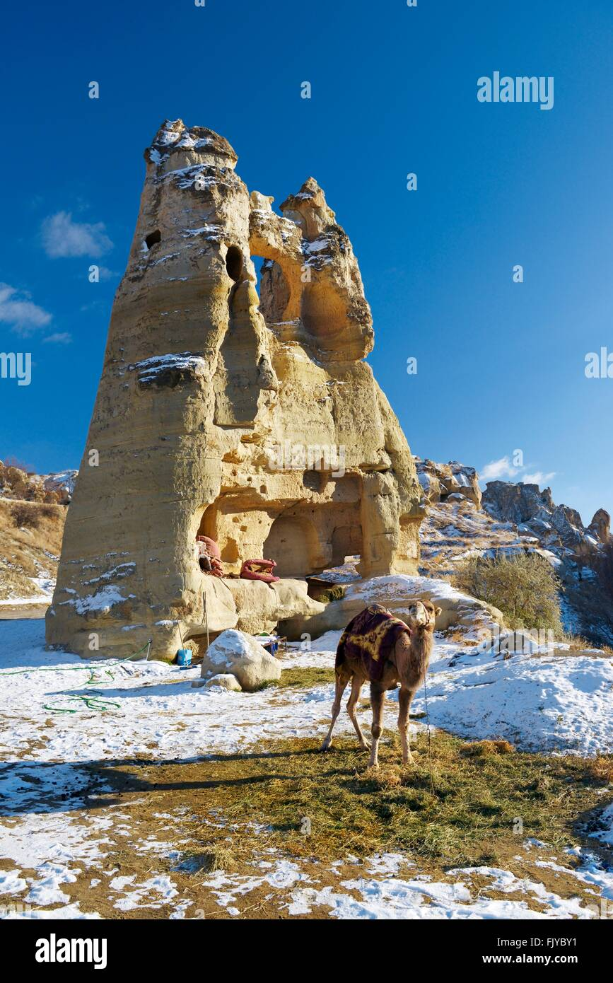 Eroded volcanic tuff early Christian troglodyte cave dwelling rooms in Goreme Open Air Museum National Park, Cappadocia, - Stock Image