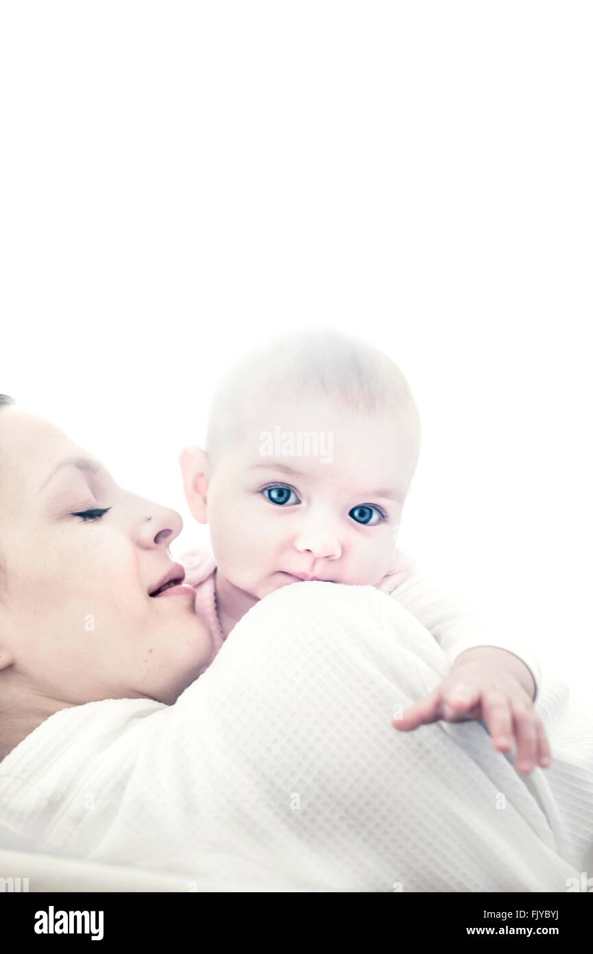 young mother with baby girl in her arms - Stock Image