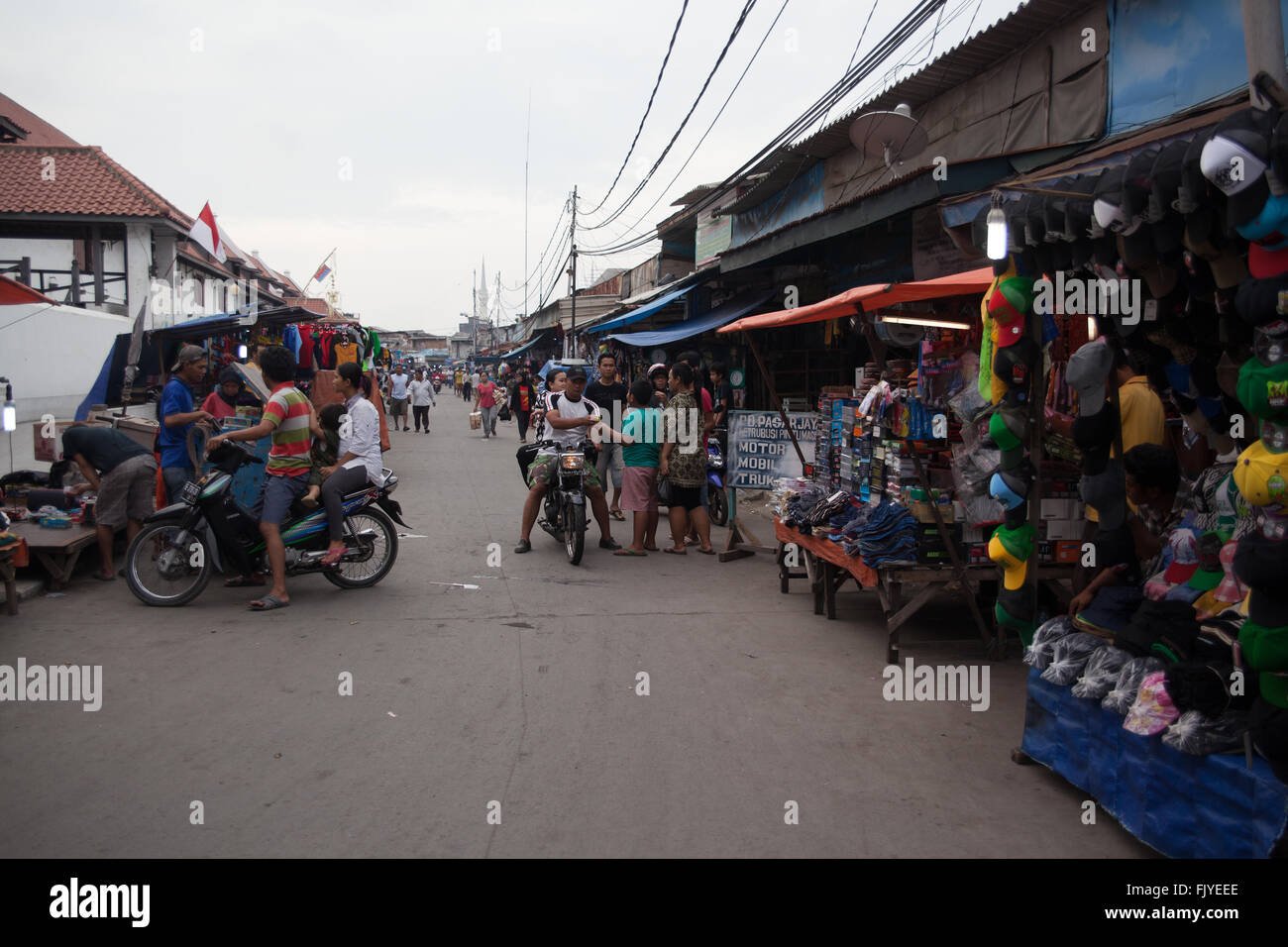 People On Street Market Against Clear Sky - Stock Image
