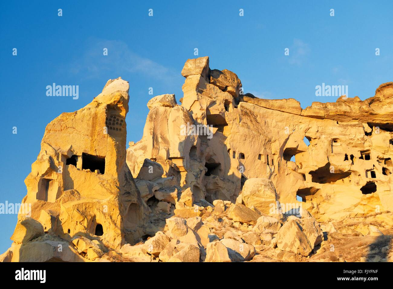 Part of cliff dwelling complex of ancient Christian churches and houses in village of Cavusin near Goreme, Cappadocia, Stock Photo