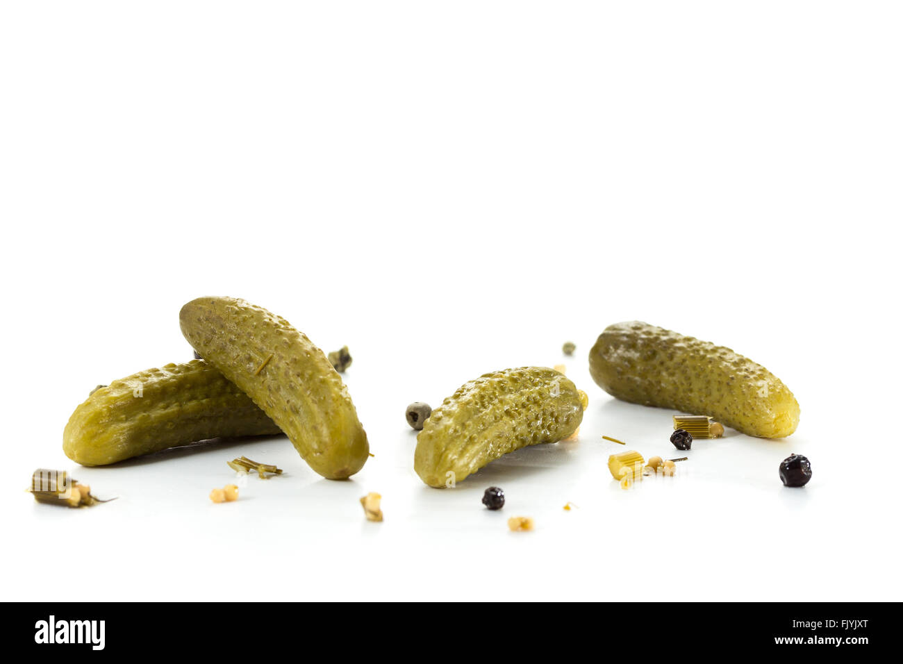 Pickled green gherkins with spices - Stock Image