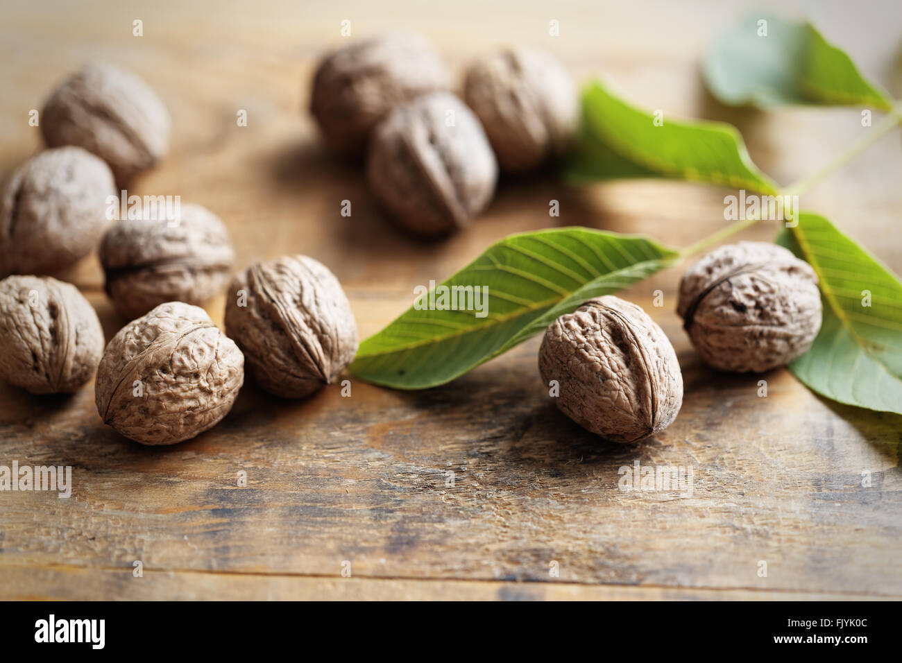 Walnuts on wooden table - Stock Image