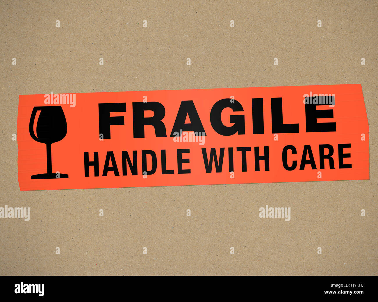 cardboard - Fragile Handle with car - Stock Image