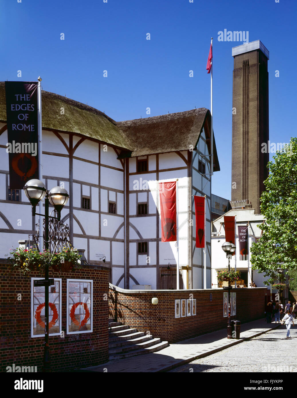 SHAKESPEARE'S GLOBE THEATRE, Bankside, London. General view of the theatre with the chimney of Tate Modern beyond. - Stock Image
