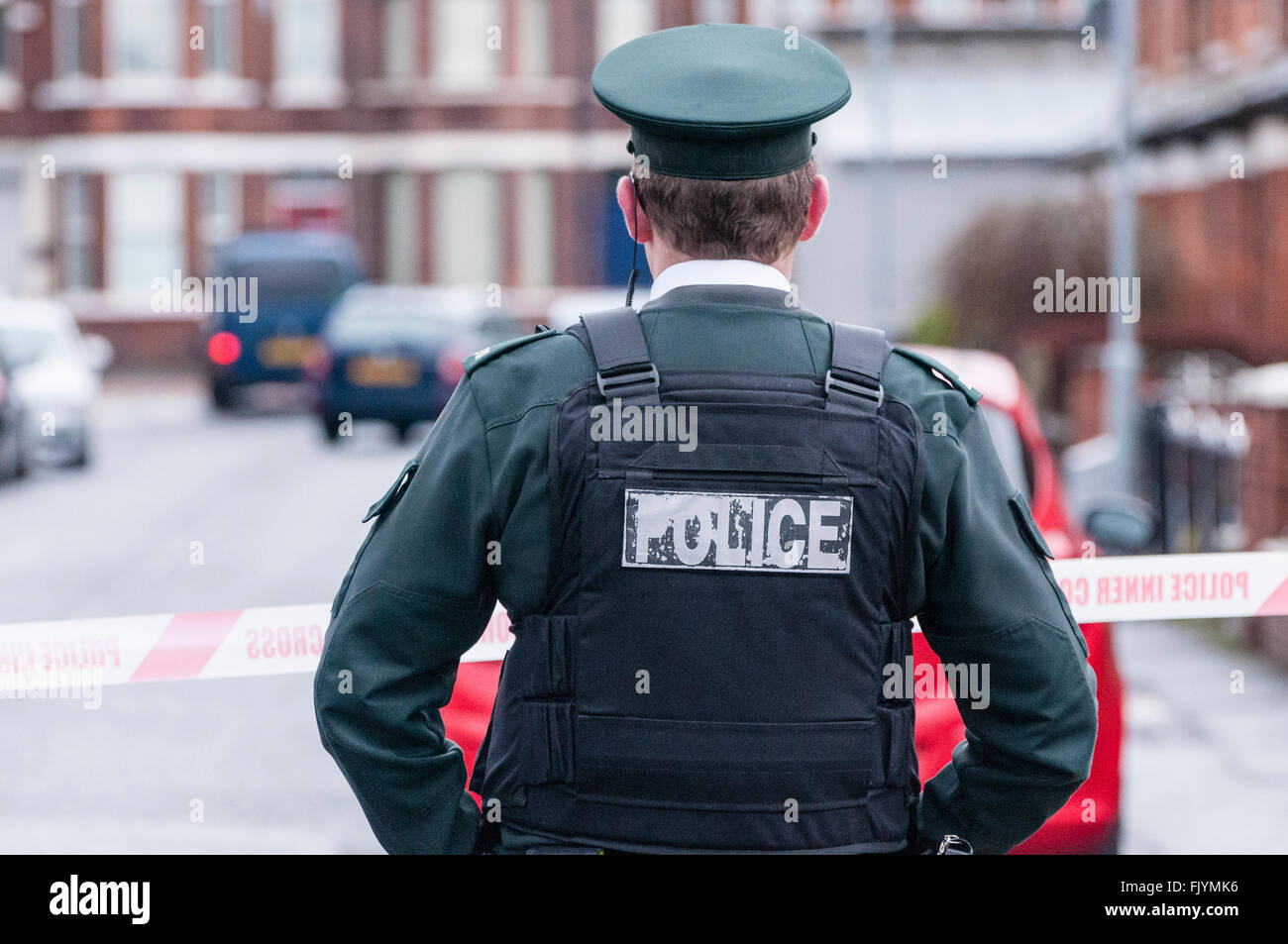 Belfast, Northern Ireland. 04 Mar 2016 - A PSNI Police Officer stands at a police cordon during a bomb alert where - Stock Image