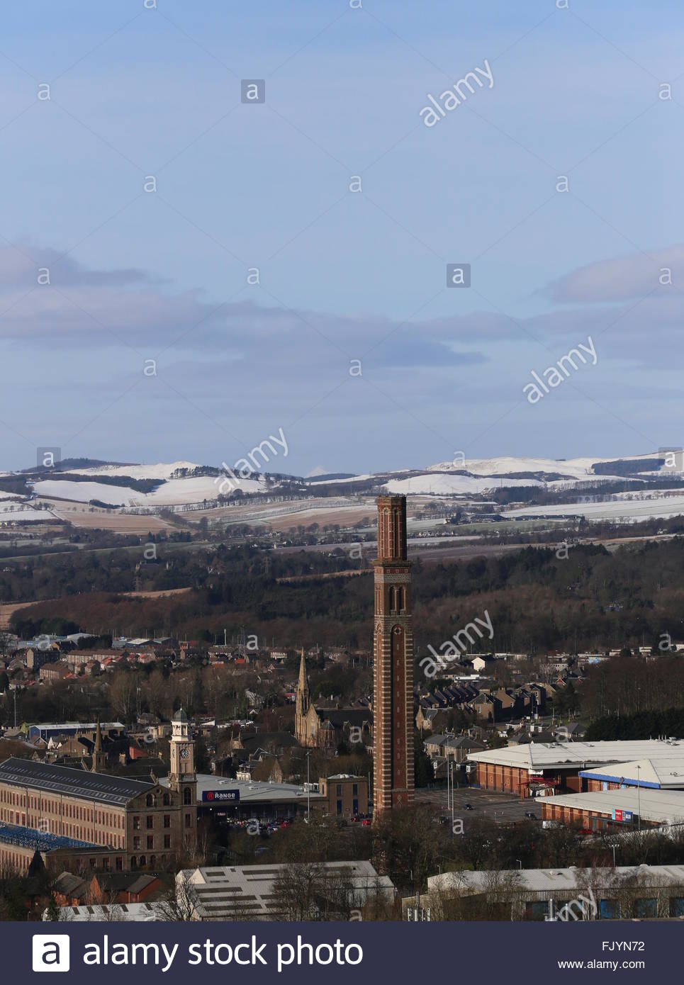 Cox's stack chimney and distant peak of Schiehallion viewed from Dundee Law Scotland  February 2016 - Stock Image