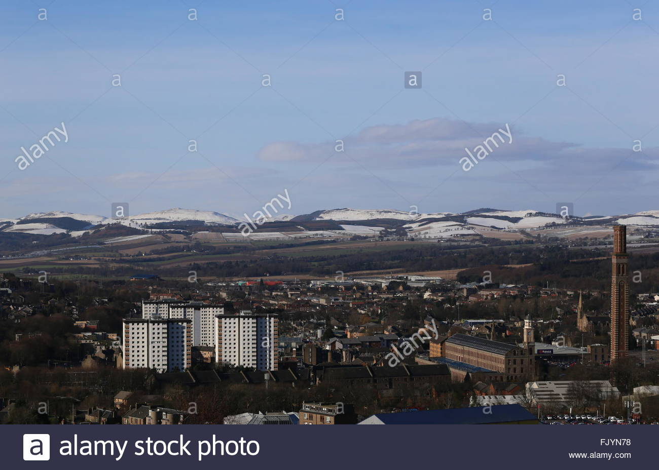 Cox's stack chimney Lochee and distant peaks viewed from Dundee Law Scotland  February 2016 - Stock Image