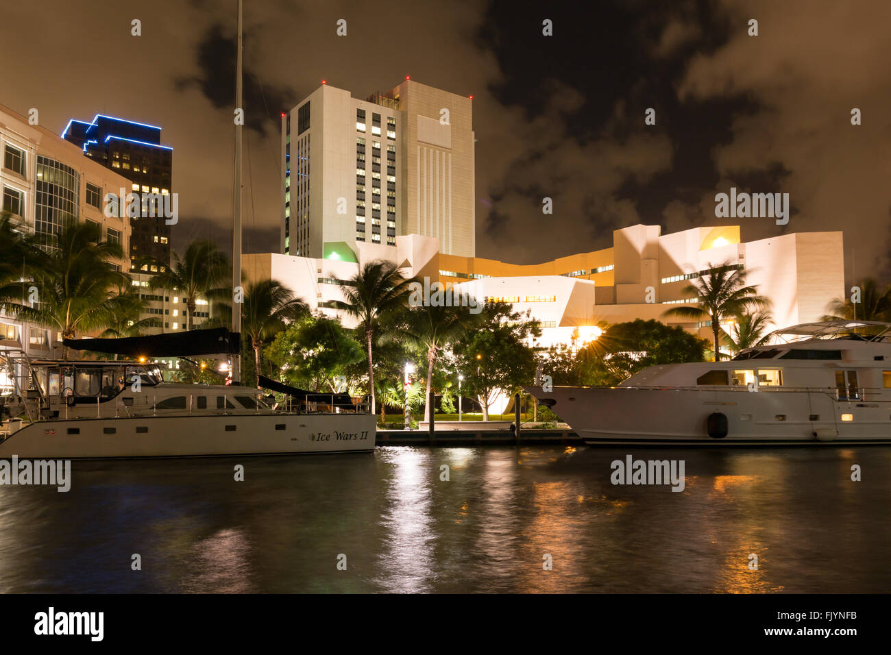 Night view of New River with yachts, modern buildings and prison in downtown Fort Lauderdale, Florida, USA Stock Photo