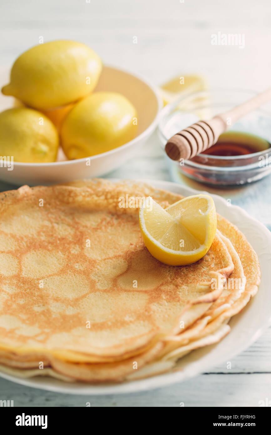 Lemon Pancakes and Bowl of Lemons - Stock Image