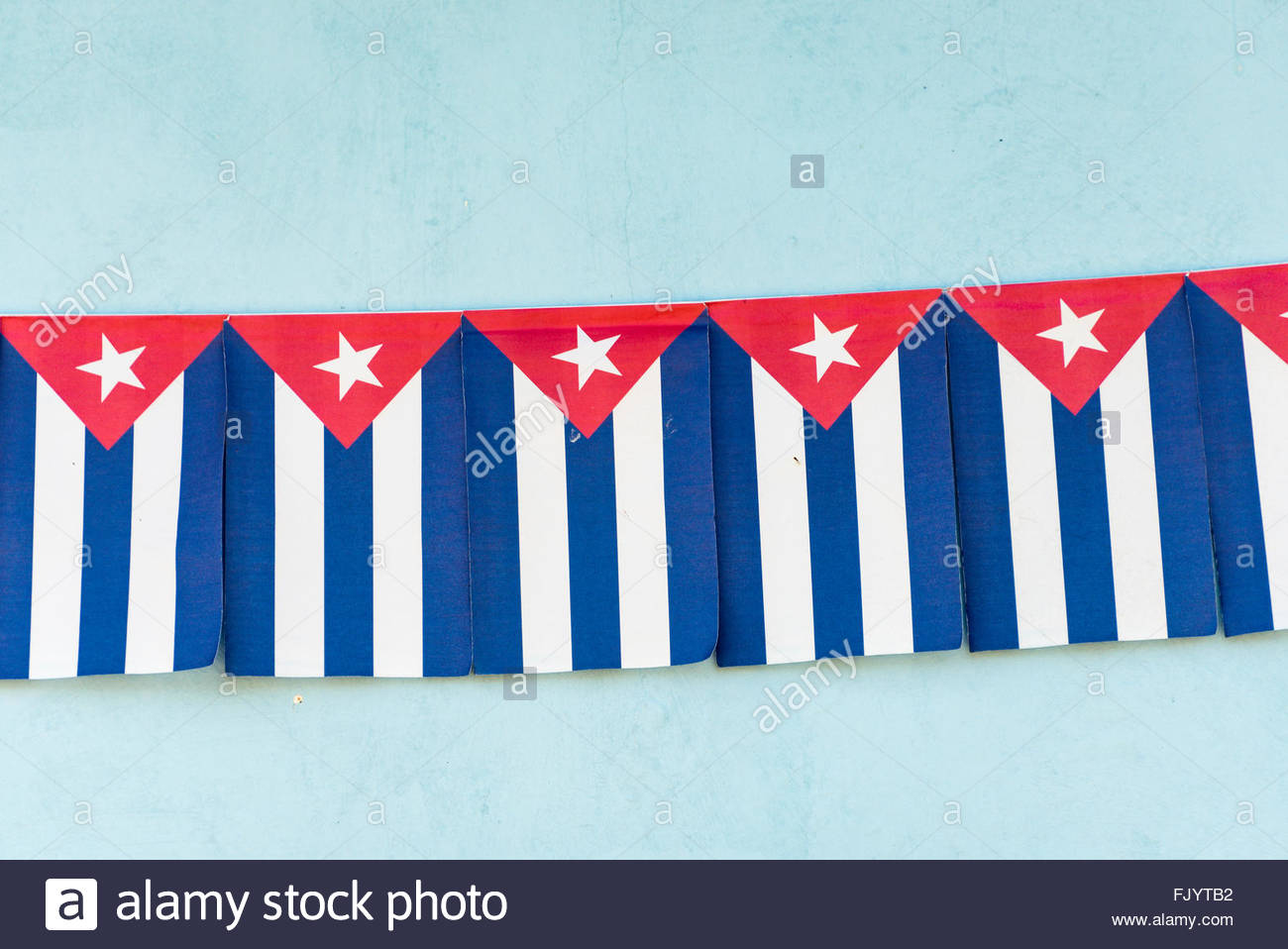 Cuban flag decorations, used in political parades.The flag of Cuba consists of five blue and white alternating stripes, - Stock Image