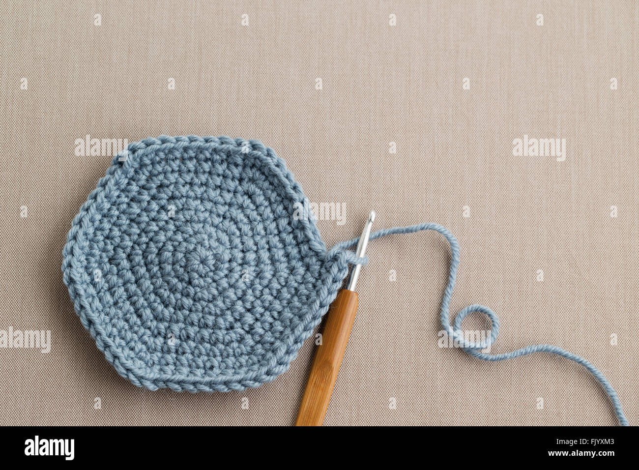 Blue wool with crochet hook - Stock Image
