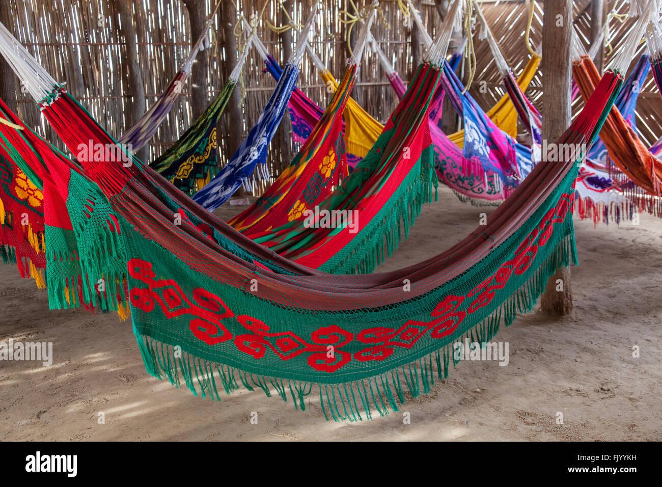 Basic hammocks accomodation for tourist in Punta Gallinos, Colombia - Stock Image