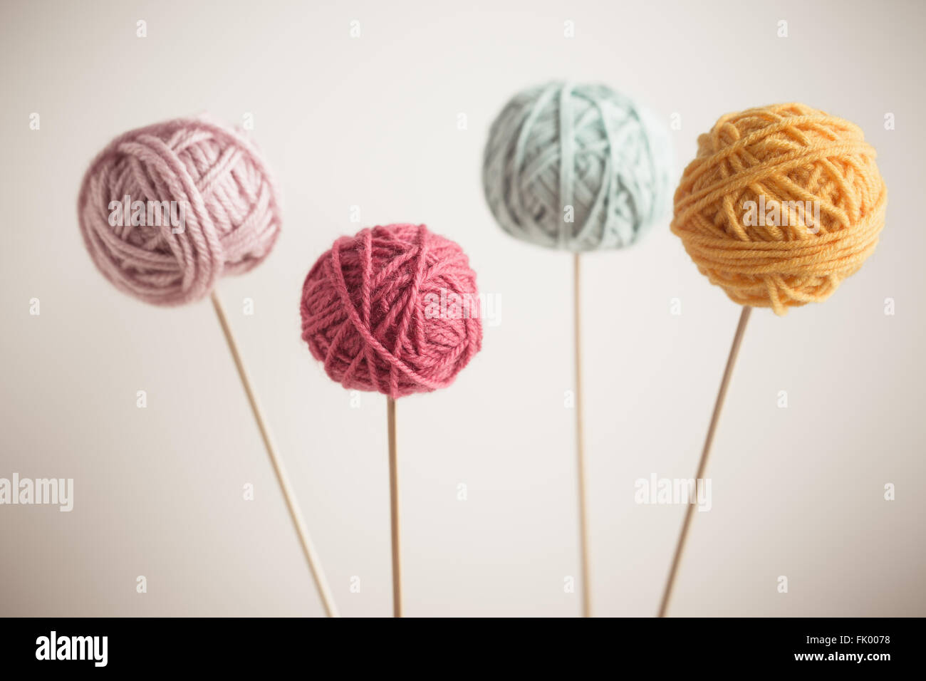 Close up of multicolor balls of yarn - Stock Image