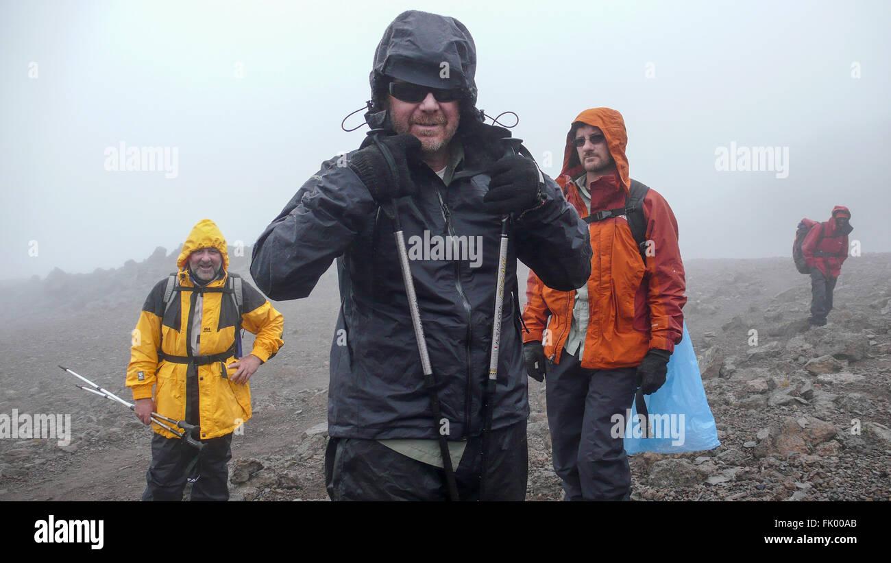 Three mountain climbers at Karanga Camp on the slope of Mount Kilimanjaro. - Stock Image