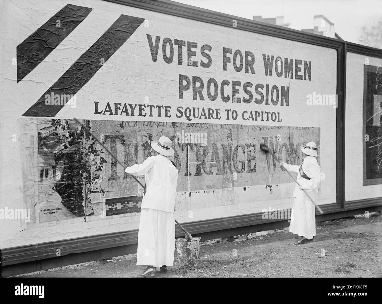 Two Women Putting Up Poster for Women's Suffrage Parade, Washington DC, USA, circa 1914 Stock Photo