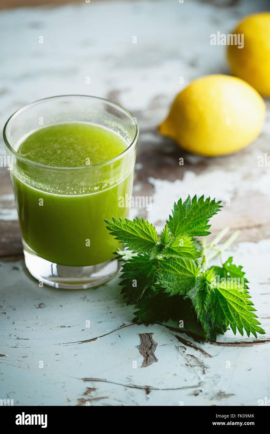 Nettle and Lemon Juice - Stock Image