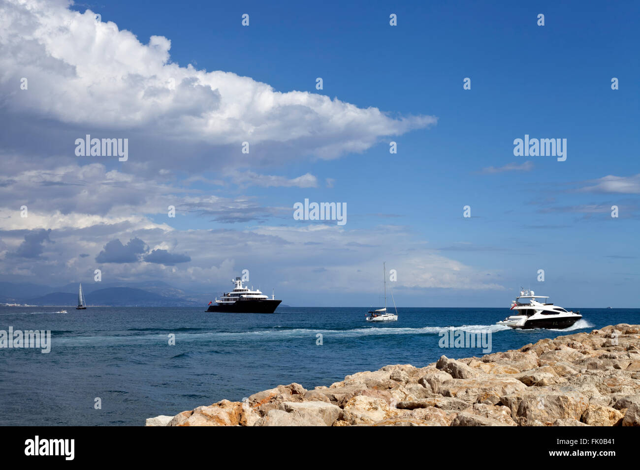 Super yachts, sail boats, motor boat sailing out in the Mediterranean sea on the French Riviera coast on a summer - Stock Image