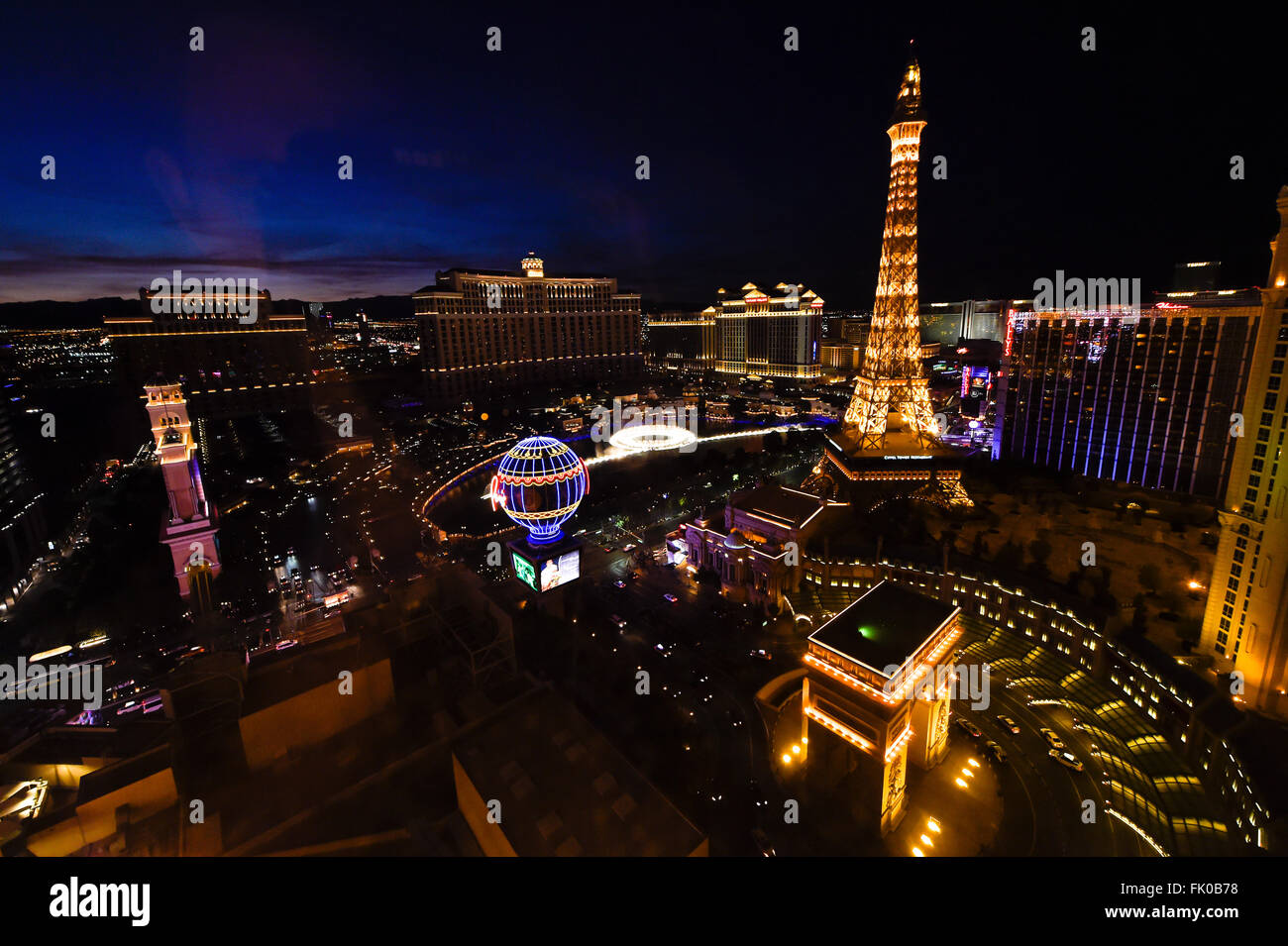 View of Paris Las Vegas and Bellagio Hotel & Casino at night - Stock Image