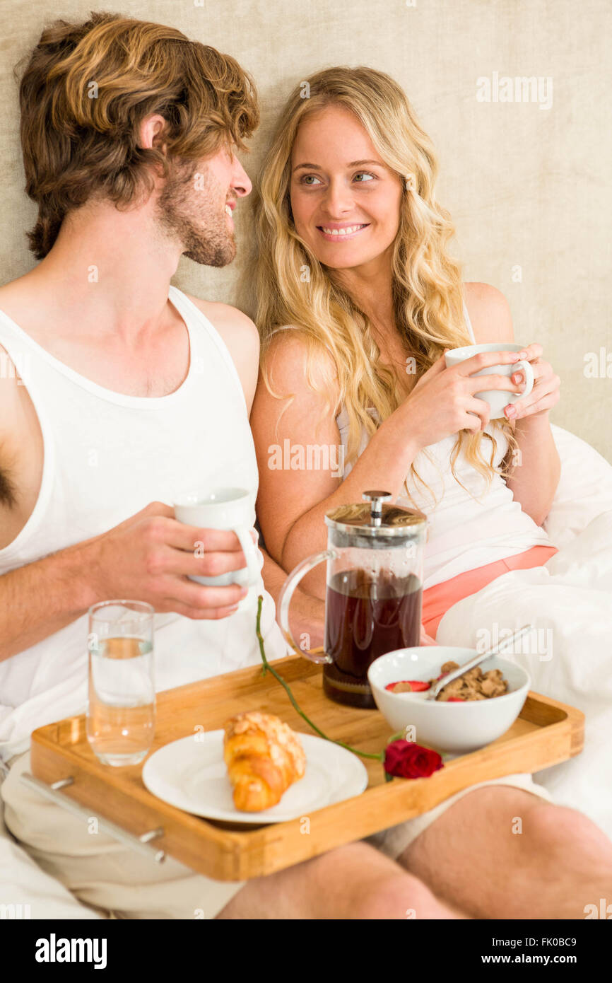 Cute couple having breakfast in bed Stock Photo