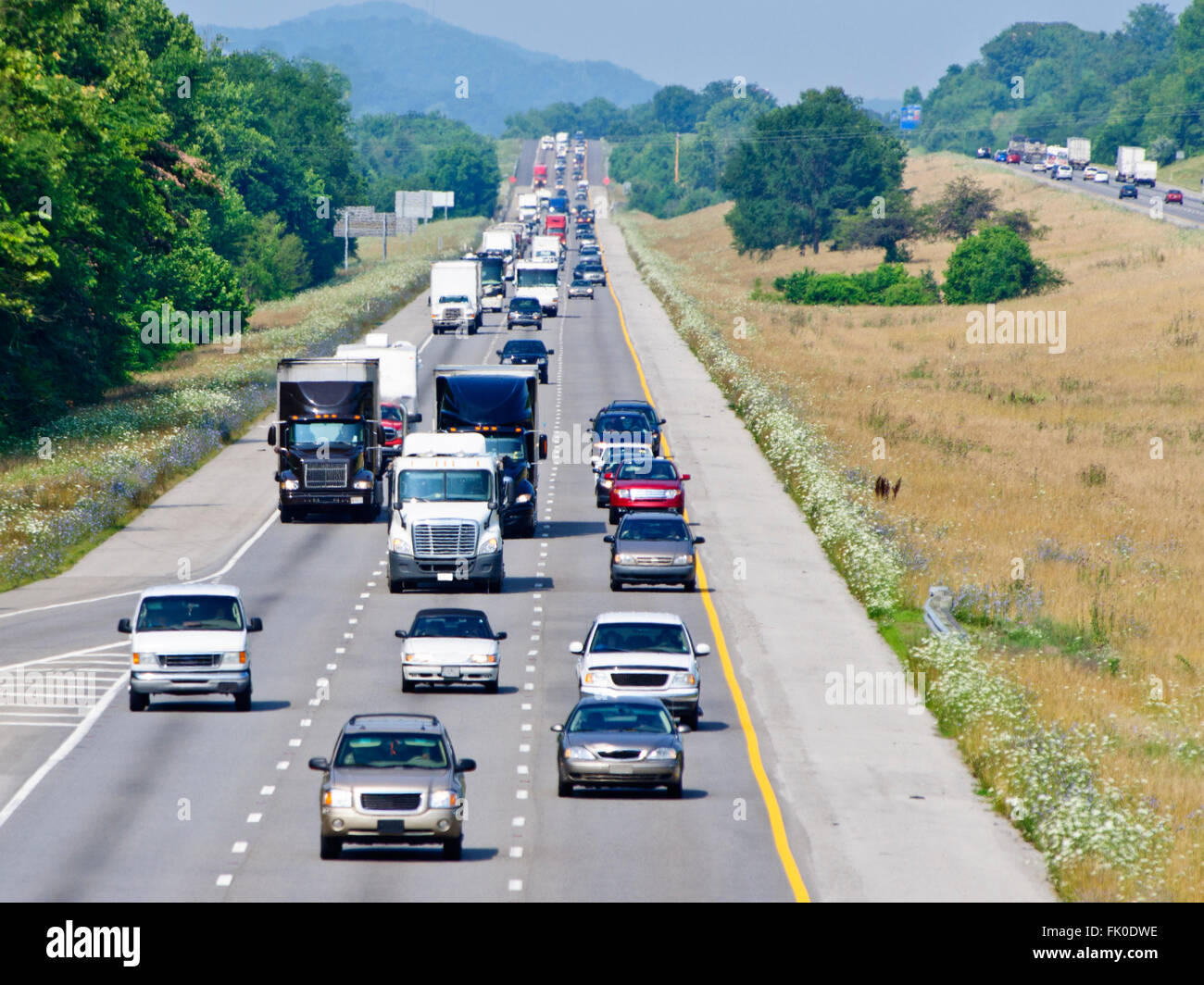 Heavy Highway Traffic On Hot Summer Day - Stock Image