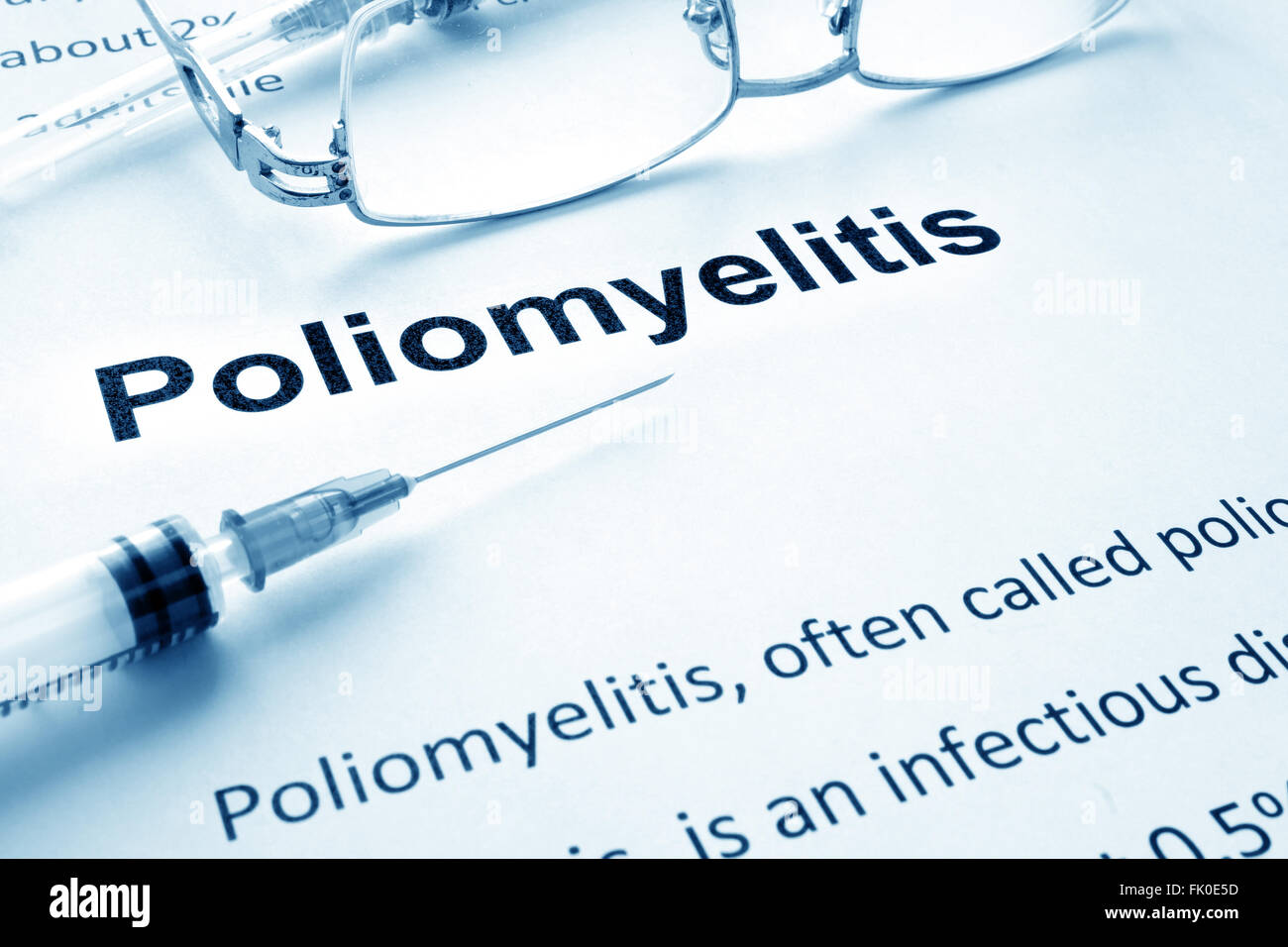 Paper with diagnosis Poliomyelitis. Polio vaccination concept. - Stock Image