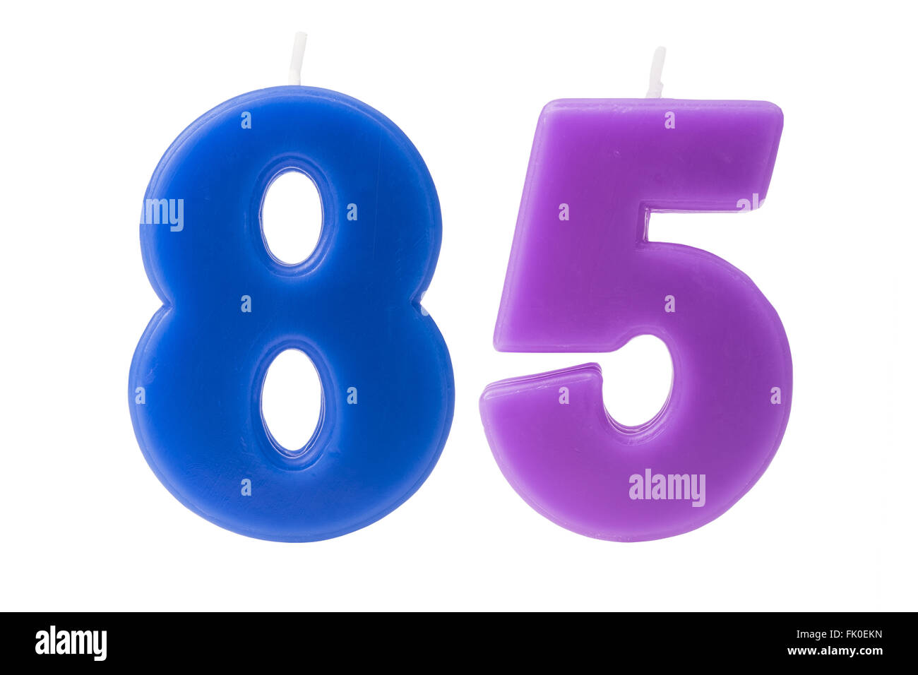 Colorful birthday candles in the form of the number 85 on white background - Stock Image