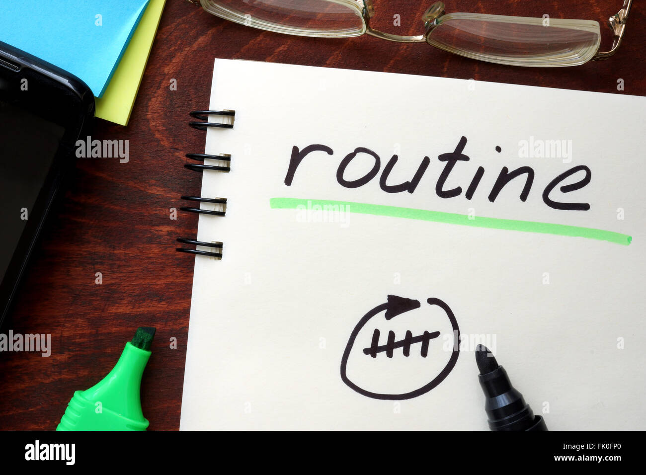 Routine written on notepad on a table. - Stock Image