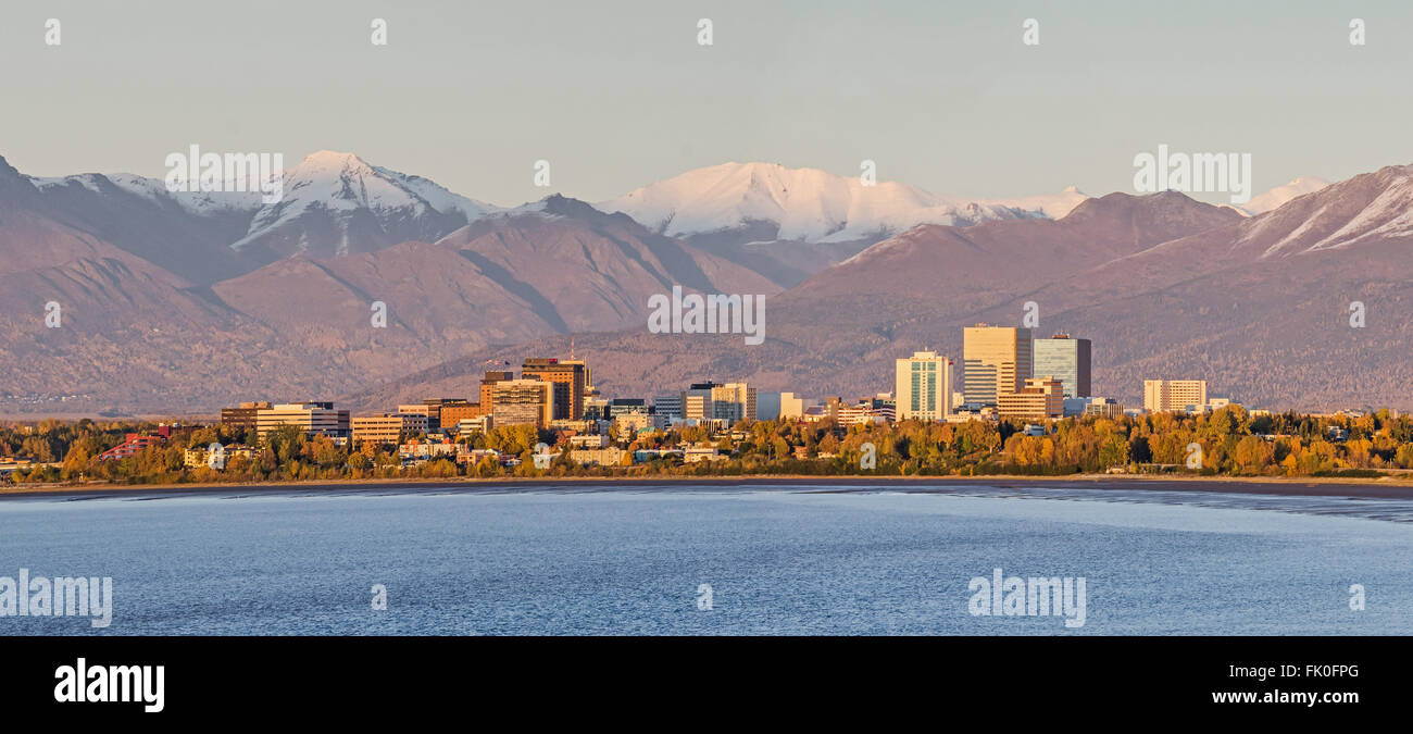 Anchorage, Alaska at sunset below the Chugach Mountains - Stock Image