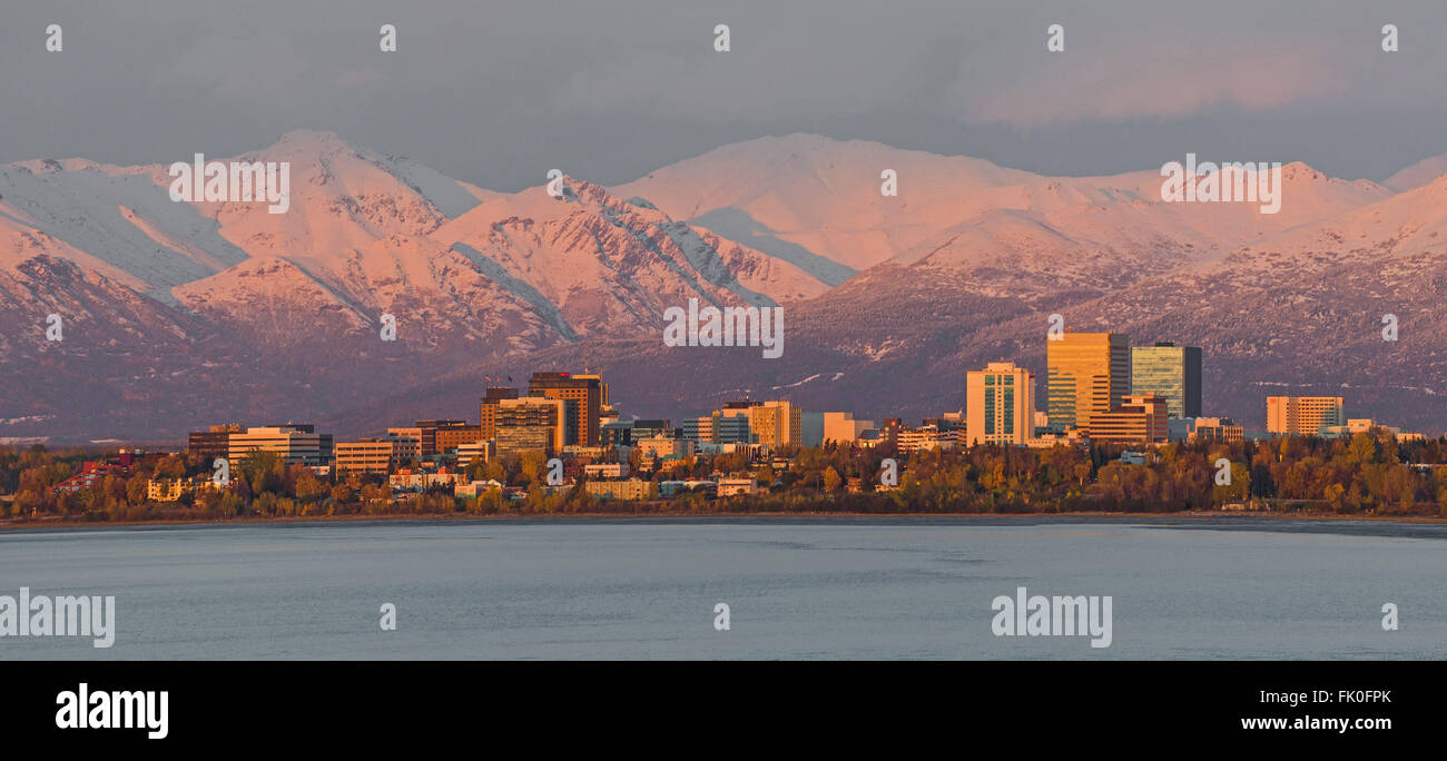 Anchorage, Alaska at sunset below the snowy Chugach Mountains - Stock Image