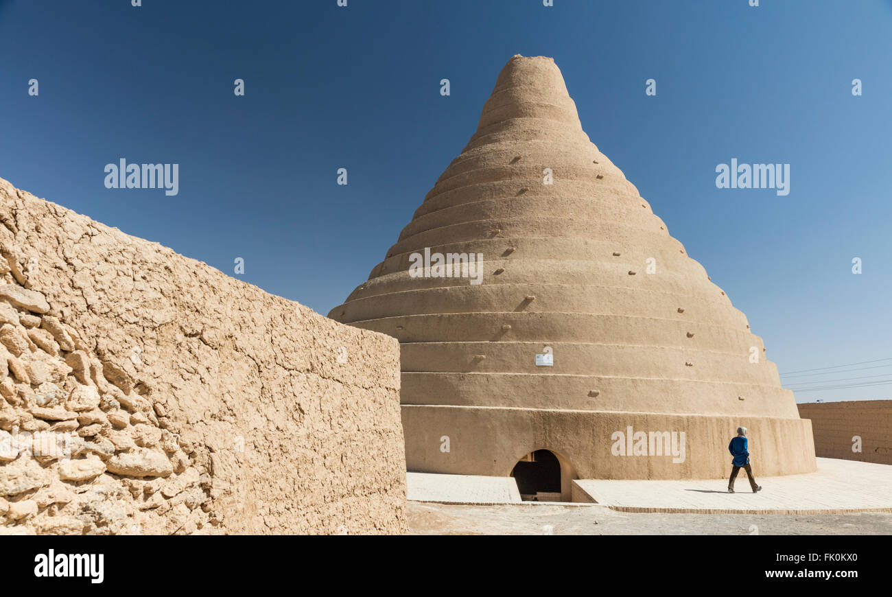Conical mud brick stepped ice house, or yakchal, at Abarku, Iran. - Stock Image