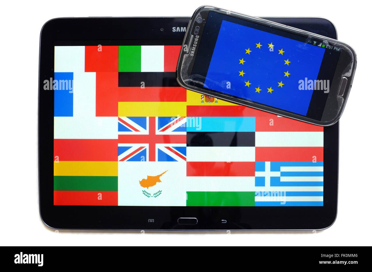 The flags of European countries and the EU displayed on the screens of a tablet and a smartphone against a white - Stock Image