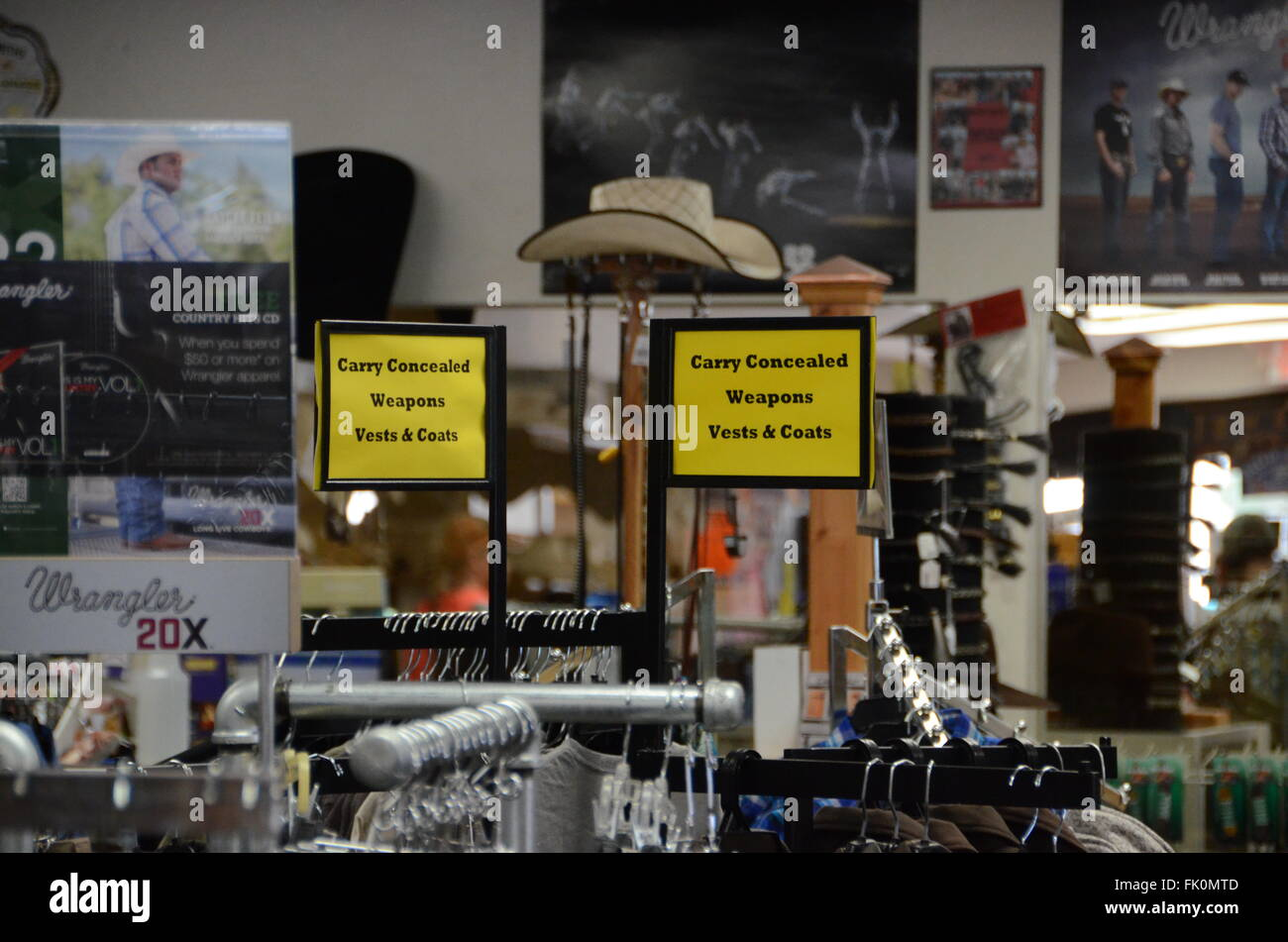 carry concealed weapons vests and coats sign cowboy shop arizona - Stock Image