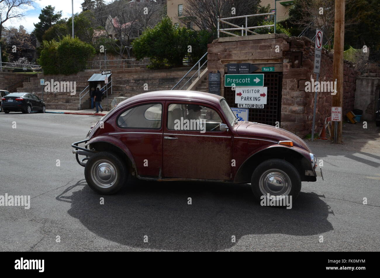 vw beetle jerome ghost town driven by old hippy main st prescott direction sigm - Stock Image