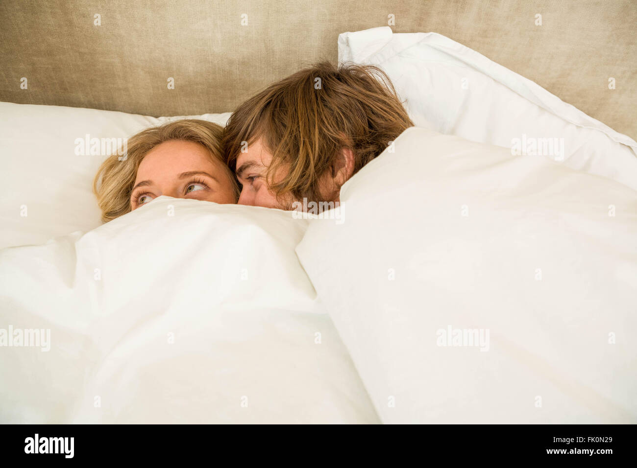 Cute Couple Cuddling Under The Blanket