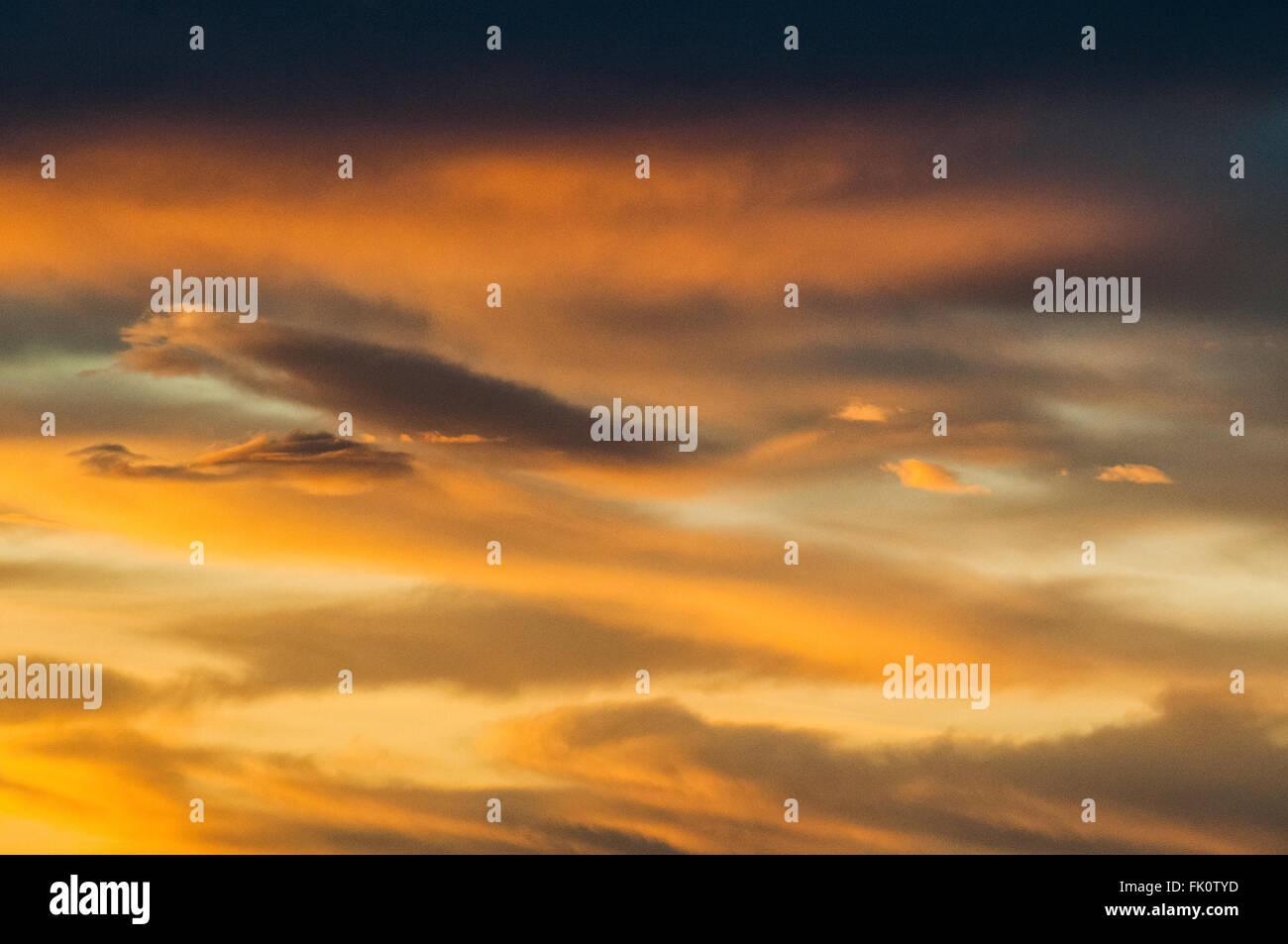Stratus clouds illuminated by the setting sun. Othello, Washington, United States. Stock Photo