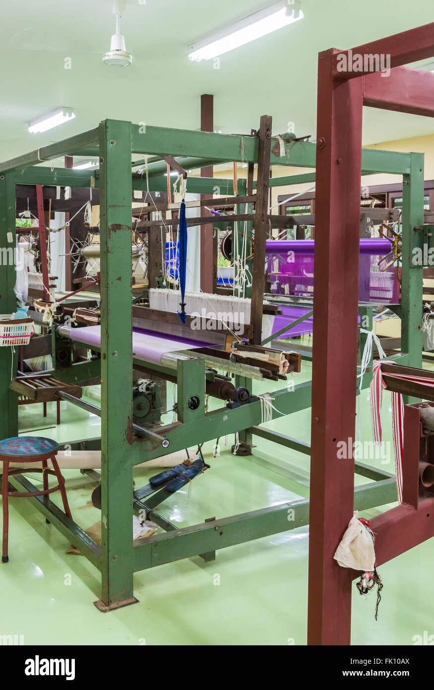 Old loom machine in the silk weaving factory. - Stock Image