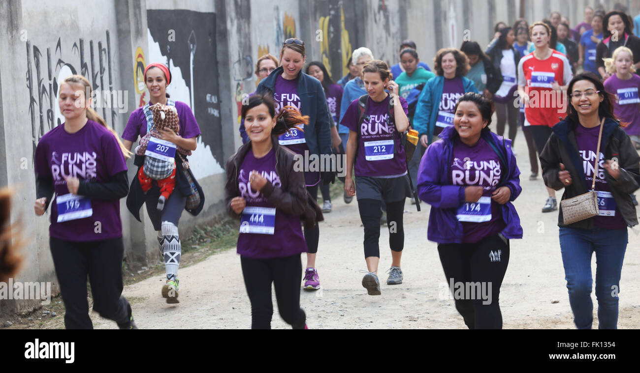 Kathmandu, Nepal. 5th Mar, 2016. People attend a 5,000-meter fun run organized to celebrate the International Women's - Stock Image