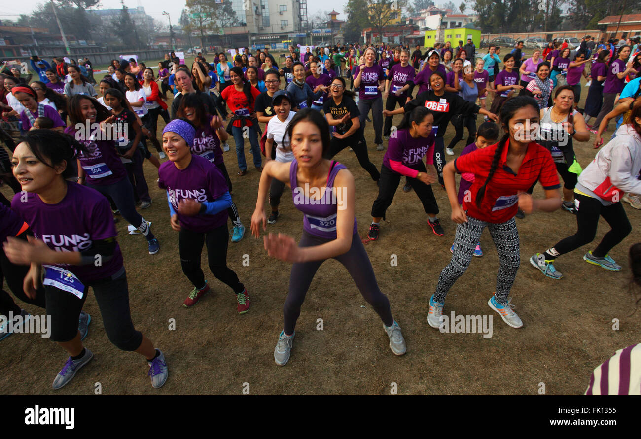 Kathmandu, Nepal. 5th Mar, 2016. People practise Zumba after a 5,000-meter fun run organized to celebrate the International - Stock Image