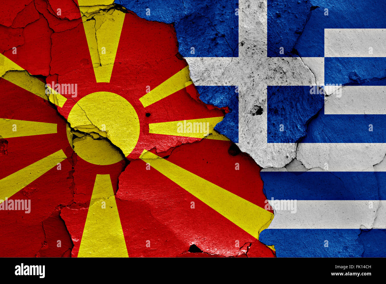 flags of Macedonia and Greece painted on cracked wall - Stock Image