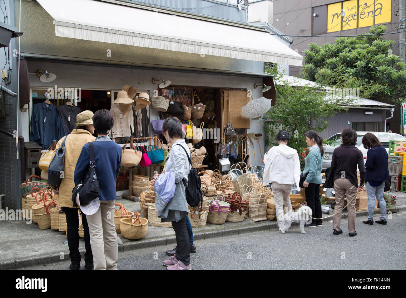 A crowd gathers outside a shop selling baskets in Yanaka Ginza, the historic section of Tokyo, Japan. Stock Photo