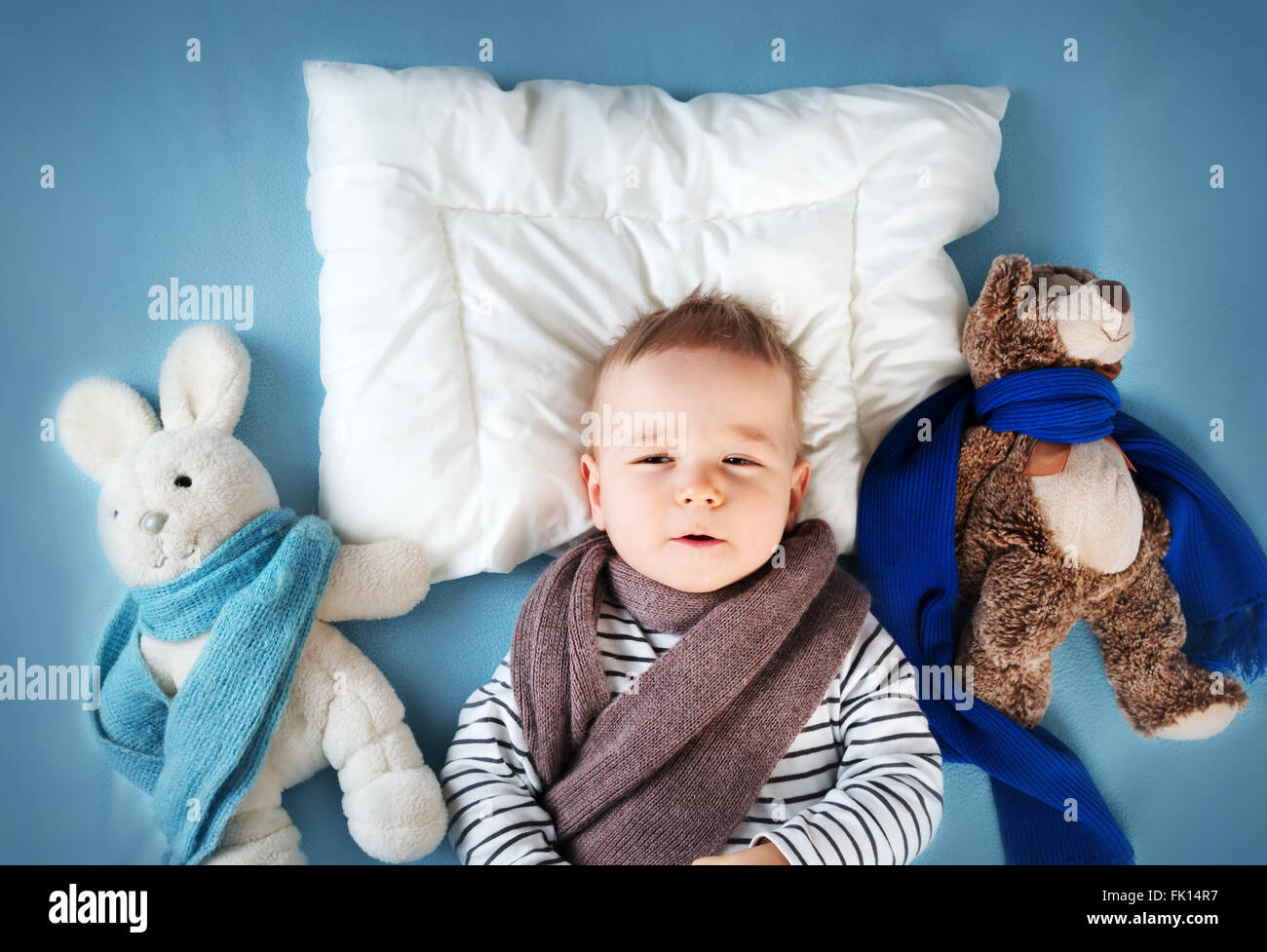 Ill boy lying in bed - Stock Image