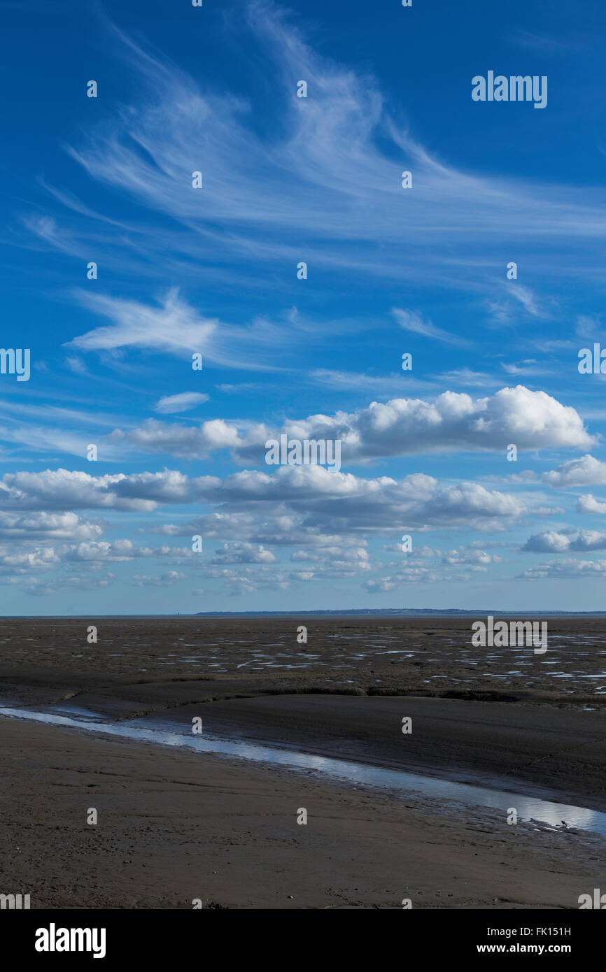 Gorgeous Early Spring Sky above Mudflats of Thames Estuary at Low Tide - Stock Image