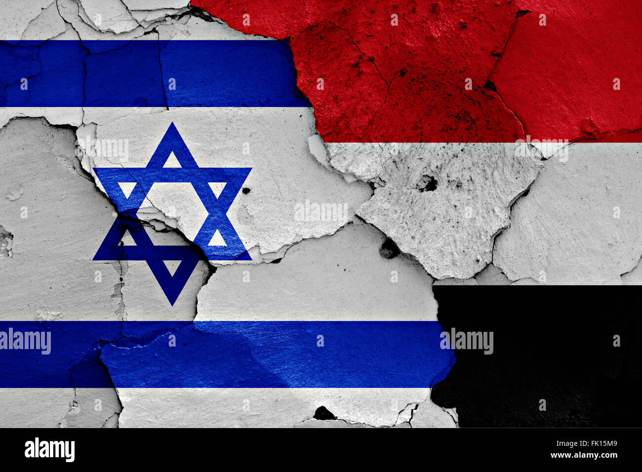 flags of Israel and Yemen painted on cracked wall - Stock Image