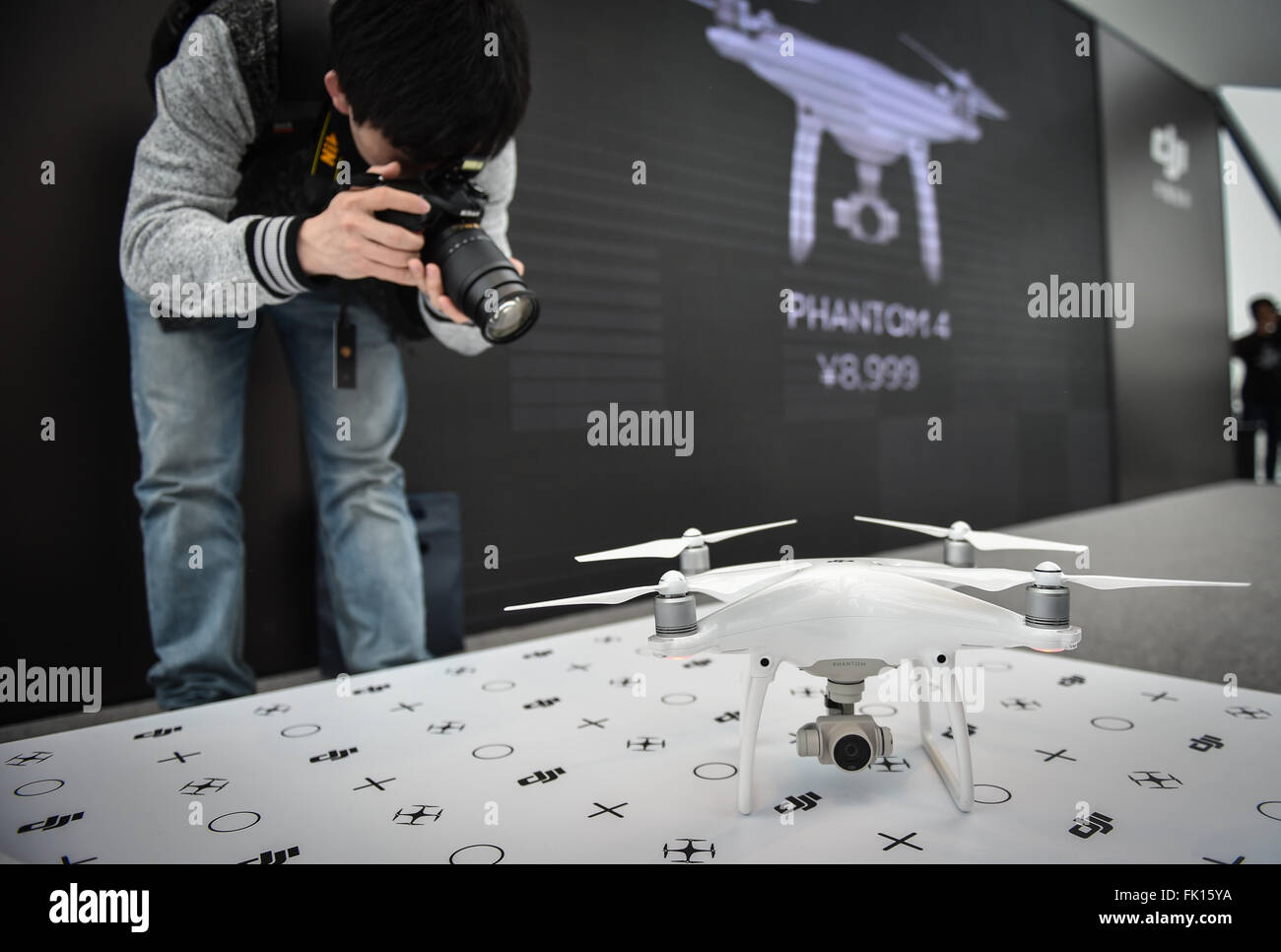 (160305) -- SHENZHEN, March 5, 2016 (Xinhua) -- A photographer takes pictures of a Phantom 4 drone developed by Stock Photo