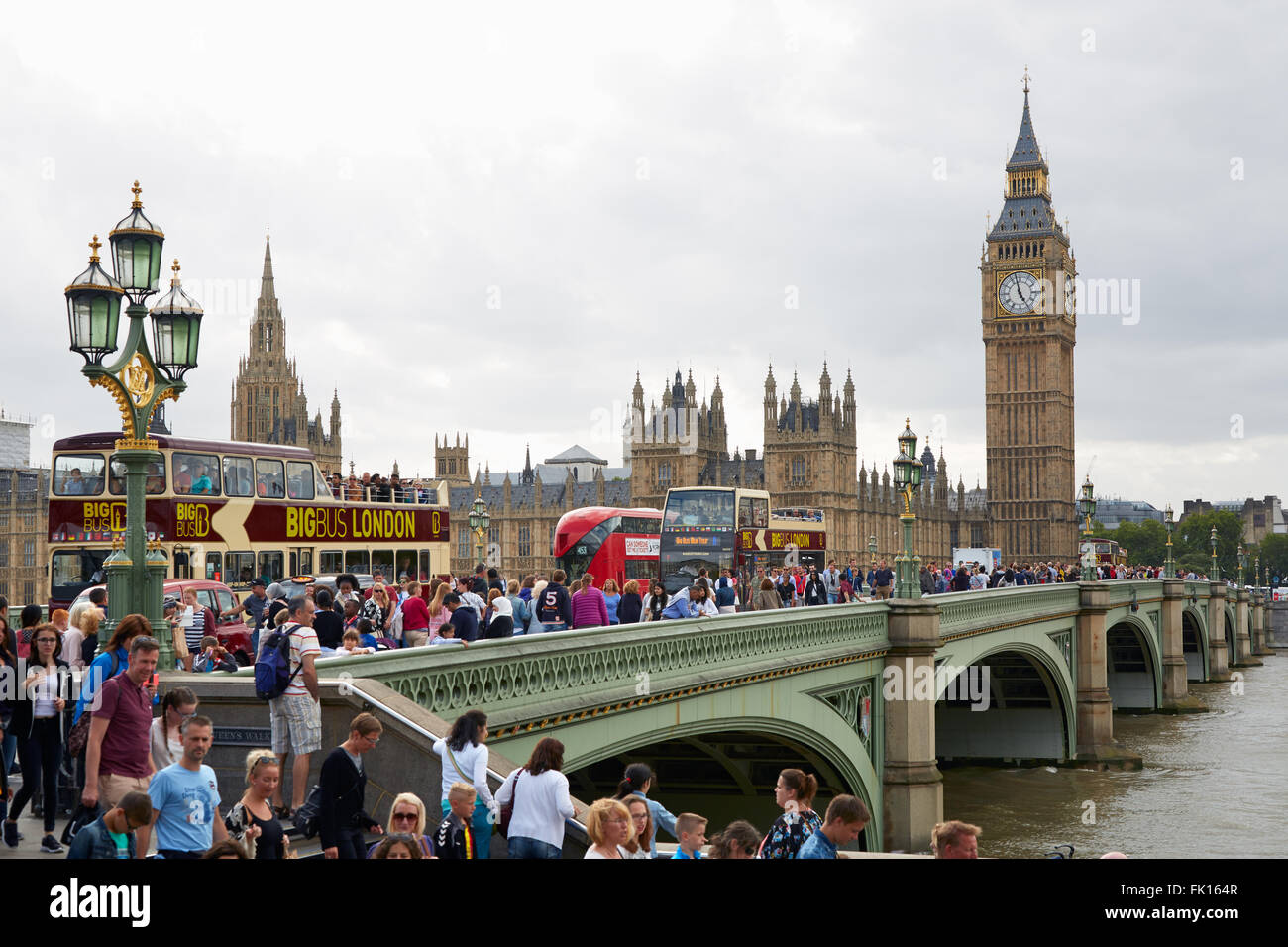 Big Ben and crowd of tourists and people in a summer day in London - Stock Image