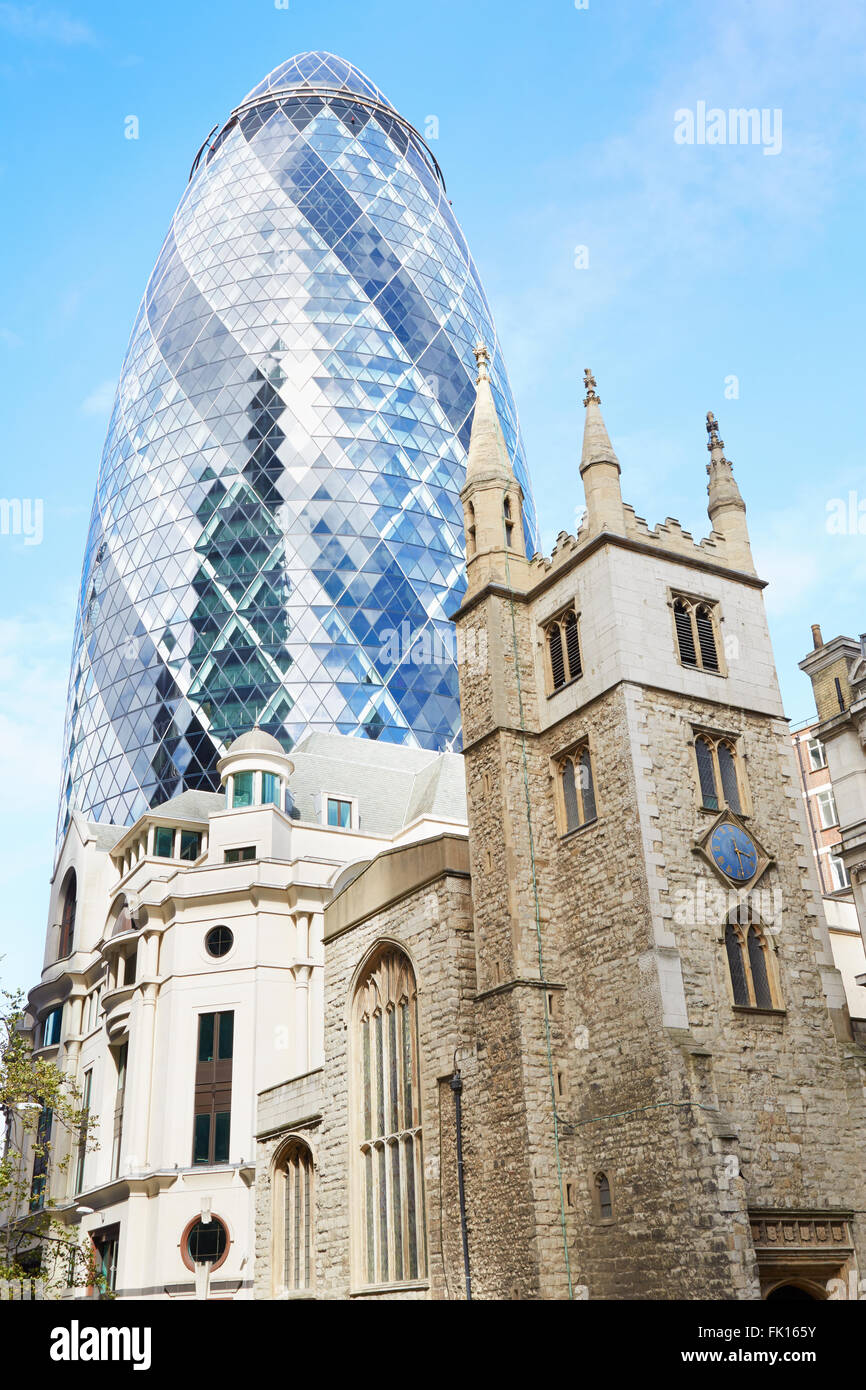 St. Andrew Undershaft Church with 30 St. Mary Axe above in a sunny day in London Stock Photo