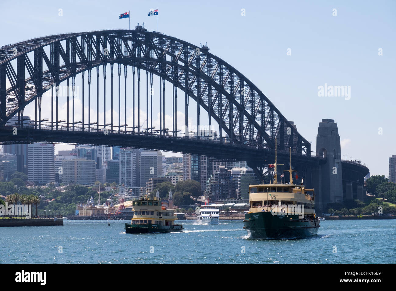 Sydney Harbour Ferries Fishburn (left) and Collaroy (right) returning into Sydney Cove, with the Sydney Harbour - Stock Image