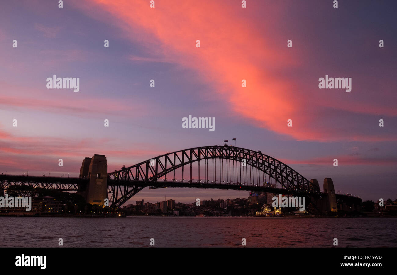 A colourful dusk over Sydney Harbour Bridge - Stock Image